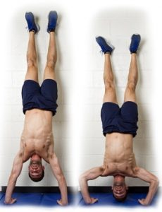 PUSH-UPS IN THE HANDSTAND AGAINST THE WALL