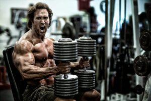 Bodybuilder Prepares for Heavy Dumbbell Press