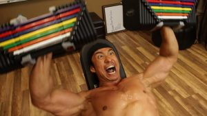 Press dumbbells on an incline bench in the home